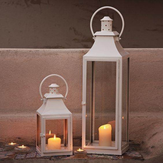 24 Unique Beautiful DIY Garden Lanterns - 18. RECYCLED WOOD SCRAPS HOLDING DELICATE CANDLES